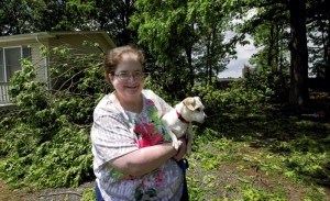 JON C. LAKEY / SALISBURY POST Tracy Presson was happily relieved that the two oak trees that fell toward her home on Ellen Street in Faith did not cause damage. Late evening thunderstorms on Tuesday brought rain, hail and menacing lightning to Rowan County. Some areas, including Faith, had winds that knocked down trees and pulled roofs off of at least one storage barn along Crescent Road.