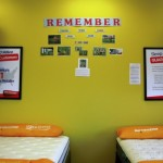 Michael Chapman, manager of the Mattress Firm at 821 E. Innes St., started a wall at the store for Memorial Day for friends and families to post pictures and information about the loved ones they have lost who served in the armed forces.  Amanda Raymond/Salisbury Post