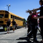 Teachers and staff say their goodbyes to students as they leave to get on the bus at Overton Elementary on Wednesday.  Allison Lee Isley/Salisbury Post