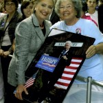 Elizabeth Smith, right, poses with Hillary Clinton during Clinton's 2008 campaign stop in Salisbury. Smith, who first met Hillary when she was first lady of Arkansas, holds an enlarged photograph she took of President Bill Clinton after he had made a campaign appearance for his wife at the depot earlier that year.  Photo courtesy of Elizabeth Smith
