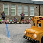 Buster the Bus spins in circles while teaching children the rules and safety precautions of riding a school bus. Allison Lee Isley/Salisbury Post