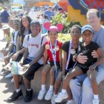 Denny Eaborn at Disney World some years back with eight of the children he adopted with wife Eugenie. Submitted photo