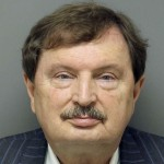 In this June 2016 photo released by the Raleigh/Wake City-County Jail, North Carolina state Sen. Fletcher Hartsell, R-Concord is shown in a booking photo.  Raleigh/Wake City-County Jail via AP