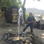 Leroy Gonzalez, who says he is the mayor of Golden, demonstrates his fountain in front of his gold mine and cantina. Photo by David Freeze