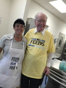 Food Lion President Meg Ham and company co-founder Ralph Ketner post for a photo at Rowan Helping Ministries. Submitted photo.