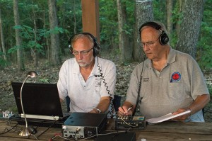 Josh Bergeron / Salisbury Post - Wayne Ashworth (right) and Mark Kelner (left) use a radio during an event at Sloan Park held by the Rowan Amateur Radio Society.