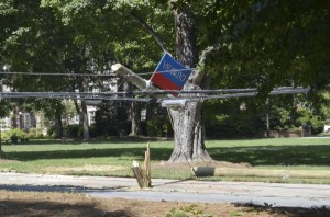 The utility pole was torn and parts of it came to rest on power lines on West Innes Street on Catawba College's campus. Shavonne Walker/Salisbury Post
