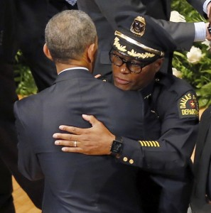 President Barack Obama , right, gives Dallas Police Chief David Brown a hug following an interfaith memorial service for five fallen officers. Brown has said officers are being asked to do too much, putting them under greater strain. AP photo