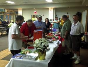 Salisbury Elk members man the table while veterans enjoy homemade Christmas cookies.