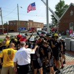 The Brotherhood riders gather at the flag pole at the firefighter memorial in Salisbury for a brief prayer. Jon C. Lakey/Salisbury Post