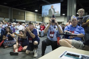 VFW members take photos as Republican presidential candidate Donald Trump speaks during a Veterans of Foreign Wars convention, Tuesday, July 26, 2016, in Charlotte, N.C. (AP Photo/Evan Vucci)
