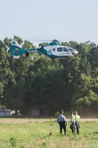 Josh Bergeron / Salisbury Post - State troopers look on as a helicopter airlifts a woman from the scene of an accident at the intersection of Miller and Weaver roads near China Grove. The woman was in critical condition when she was airlifted.
