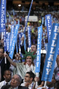 Delegates hold up Hillary signs at the convention.