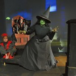 Sara Richard portrays the Wicked Witch, with the flying monkeys (Ellie Cardelle in front left and Mary Grace Cardelle, in back) in 'The Wizard of Oz.'  Wayne Hinshaw/For the Salisbury Post