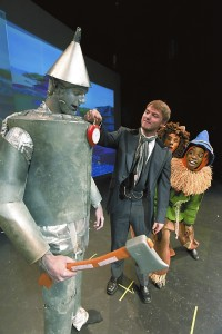 The Wizard ( Hunter Baynes) pins a heart on the Tin Man (Corbit Elliott) with the Lion  Ryan Albinus and the Scarecrow (Keshun Bradley) on the right. photo by Wayne Hinshaw, for the Salisbury Post