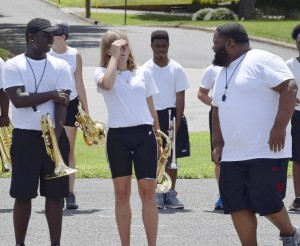North Rowan High School's marching band may be small, but students say it's like a family — and in competitions the band can keep up with the best of them. Left to right: Terry Larke, Aubree Cain and Band Director Sir Davis chat during a brief break in practice. Rebecca Rider/Salisbury Post