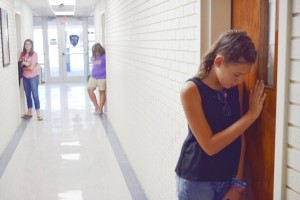 Abbey Deaton, a seventh grader at North Hills Christian School, says a prayer over an office in the school's administrative wing. Deaton and other students at the school spent Thursday morning on a prayer walk around North Hills' campus. Rebecca Rider/Salisbury Post