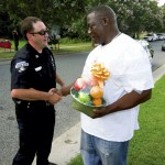 Daniel Matangira, owner of Matangira Recycling Service, shakes hands with Salisbury Police Captain Brian Stallings and present him with a token of appreciation.  Jon C. Lakey/Salisbury Post
