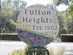 Amanda Raymond/Salisbury Post Fulton Heights unveiled a new sculpture, named Trolley Fare, at a community picnic last weekend. The mosaic sculpture includes elements from the neighborhood's history, including when the neighborhood was established with the original plat map of the neighborhood, a green bar to represent the trolley track that used to go down Mitchell Avenue and roses to represent the commercial rose houses on Elm Street.