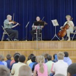 Left to right: Dan Skidmore, Carter Bradley and Gayle Masarie play for third and fourth graders at Landis Elementary Tuesday. The Salisbury Symphony has been holding mini concerts in district elementary schools for more than 25 years. Rebecca Rider/Salisbury Post.