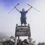 Kyle Shores celebrates the completion of his 2,189.1-mile through hike at the summit of Mount Katahdin, the northern terminus of the Appalachian Trail. Submitted photo