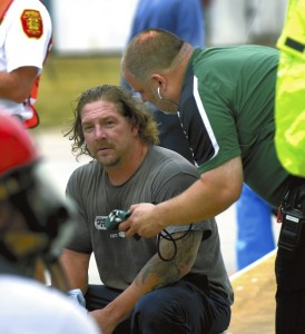 A Akzo Noble employee who was a member of the hazmat team that entered the plant during the drill, came out of the drill and surprised  the EMS team by faking a heart attack as part of the drill.  They EMS team were not expecting this part of the drill.   photo by Wayne Hinshaw, for the Salisbury Post
