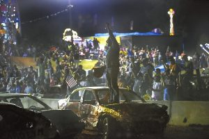 A drive who was knocked out of the race early celebrated for the winning driver in the compact car category in the Demolition Derby.photo by Wayne Hinshaw, for the Salisbury POST