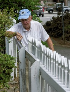 JON C. LAKEY / SALISBURY POST Bud Mickle applies a fresh coat of paint on the picket fence in front of the Rowan Museum's Utzman Chambers house on South Jackson Street on Thursday in advance of the upcoming October Tour.  Thursday, September 15, 2016, in Salisbury, N.C.