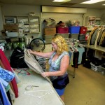Volunteer Kimberly Snow sorts clothing donations in the area that was a kitchen that served countless meals to the needy. It's now part of the Rowan Helping Ministries Ralph W. Ketner Center. Jon C. Lakey/Salisbury Post