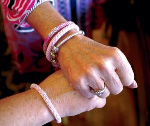 Close friends Ann Eidson and Janet Haynes wear matching pink bracelets as a sign of solidarity in their joint fight against breast cancer. Mark Wineka/Salisbury Post