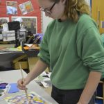 Madison Welborn works on a piece of art that when finished will included a special message. Susan Shinn/For the Salisbury Post