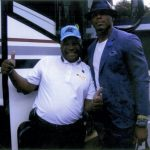 Gary Roseborough outside his bus with Carolinas Panthers quarterback Cam Newton. Submitted photo