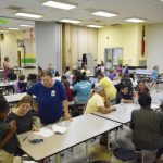 Families eat together during Engage, a Tuesday night meal and information session at North Rowan Elementary. Principal Katherine Bryant and PTA President Cybil Jones started Engage to strengthen ties between parents and children and the school and the community. Rebecca Rider/Salisbury Post