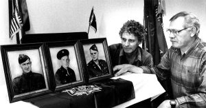 Buddy Kyles and Jim Arnold are shown in this 1991 photo with pictures of the founding members of the Hudson-Miller-Tatum Veterans of Foreign Wars Post 3006. The Post is celebrating its 75th anniversary later this month. File photo by Wayne Hinshaw