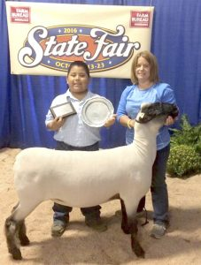 Submitted photo Talton Correll won Champion AOB Ewe. On the right is mother Cheryl Correll.