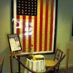 Powles Staton Funeral Home's military-themed lounge area includes a POW/MIA Table, set for one person. Each element in the display — the empty chair, white tablecloth, Bible, yellow candle, black napkin, inverted wine glass and more — carries symbolism in recognition of prisoners of war and those missing in action. Mark Wineka/Salisbury Post