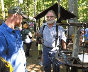 "Blacksmith Jim Sabo talks with a man at his ""Jeep Forge""  at the Autumn Jubilee at Dan Nicholas Park. The event continues today, from 10 a.m. to 6 p.m. Admission and parking are free. Wayne Hinshaw, for the Salisbury Post"