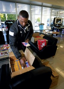 """Charles """"Trey"""" Holloway III, a detailer at Cloninger Ford in Salisbury, felt compelled to take up donations to help  victims of flooding in the Lumberton area. Jon C. Lakey/Salisbury Post"""