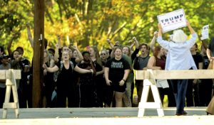 Catawba College students protesting the rally Monday chant as supporters of speaker Mike Pence and his running mate, Republican presidential candidate Donald Trump, leave the event. Jon C. Lakey/Salisbury Post