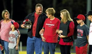 JON C. LAKEY / SALISBURY POST Family members and former athletes of South Rowan Coach Larry Deal gathered on the football field prior to the start of the game. His wife, Diane, (center) was joined by her family on the field before the game. Her children Andrew Deal (left) and daughter Angie Chrismon (right) flank her. Friday, October 28, 2016, in Landis, N.C.