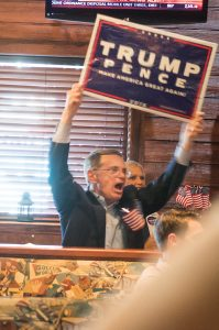 Josh Bergeron / Salisbury Post - Salisbury resident Ronnie Smith pumps up the crowd during a Trump event at Thelmas Down Home Country Cooking.