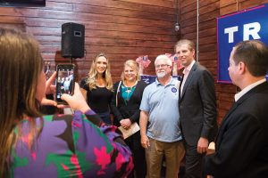 Josh Bergeron / Salisbury Post - J.R. Rufty, middle left, and Ken Rufty, middle right, pose with Eric and Lara Trump on Friday during an event in Salisbury.