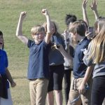 Seventh graders at Corriher-Lipe Middle cheer when their catapult design flings a pumpkin farther than other groups' designs. Rebecca Rider/Salisbury Post