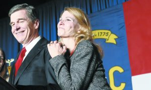 File - North Carolina Democratic candidate for governor Roy Cooper and his wife Kristin greet supporters during an election night rally in Raleigh. (AP Photo/Gerry Broome)