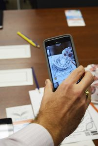 Andrew Smith, director of digital innovation with Rowan-Salisbury Schools, uses his cellphone to demonstrate an app that will turn a 2D worksheet into a 3D, digital, interactive model. Rebecca Rider/Salisbury Post