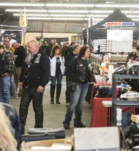 Josh Bergeron / Salisbury Post - Motorcycle enthusiasts on Sunday look through accersories and other merchandise being sold by vendors at the Rowan County Fairgrounds. The Charlotte Concerned Bikers Association held a swap meet and bike show at the fairgrounds.