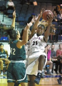 Wayne Hinshaw/for the Salisbury Post ... Catawba's Terri Rogers (21) rebounds against Mount Olive's Makayla Nichols (12). Rogers led Catawba to victory with 29 points and 15 rebounds.