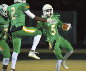 North Rowan's  DeAndre Gray 5 catching a long pass and running for a TD and celebrating with  Alonzo Sirleaf 2. .      photo by Wayne Hinshaw, for the Salisbury Post