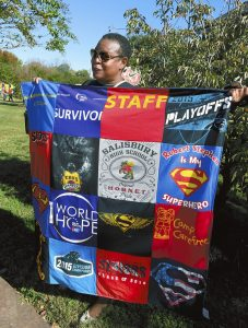 Wendy Gilmore-Baskins  holding a blanket made from her son, Stephen Gilmore's,  T-shirts at the Voices of Hope Event. photo by Wayne Hinshaw, for the Salisbury Post