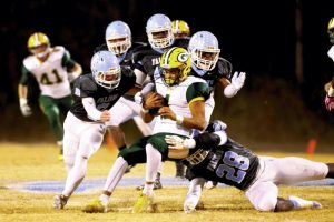 James Sipes/for the Salisbury Post Crest's quarterback was under pressure all night as West Rowan's Rodney Howell (28), Brandon Wallace (8), LJ Robinson (22) and Devin Turner (44) combine on a sack and a loss of 17 yards. West won the 3A second round playoff game on Friday night, 35-7.
